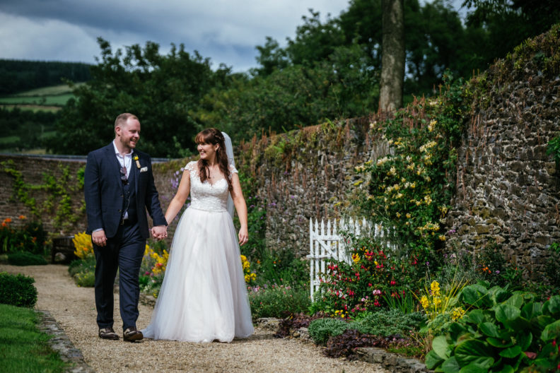 bride and groom walking in garden of ballybeg house