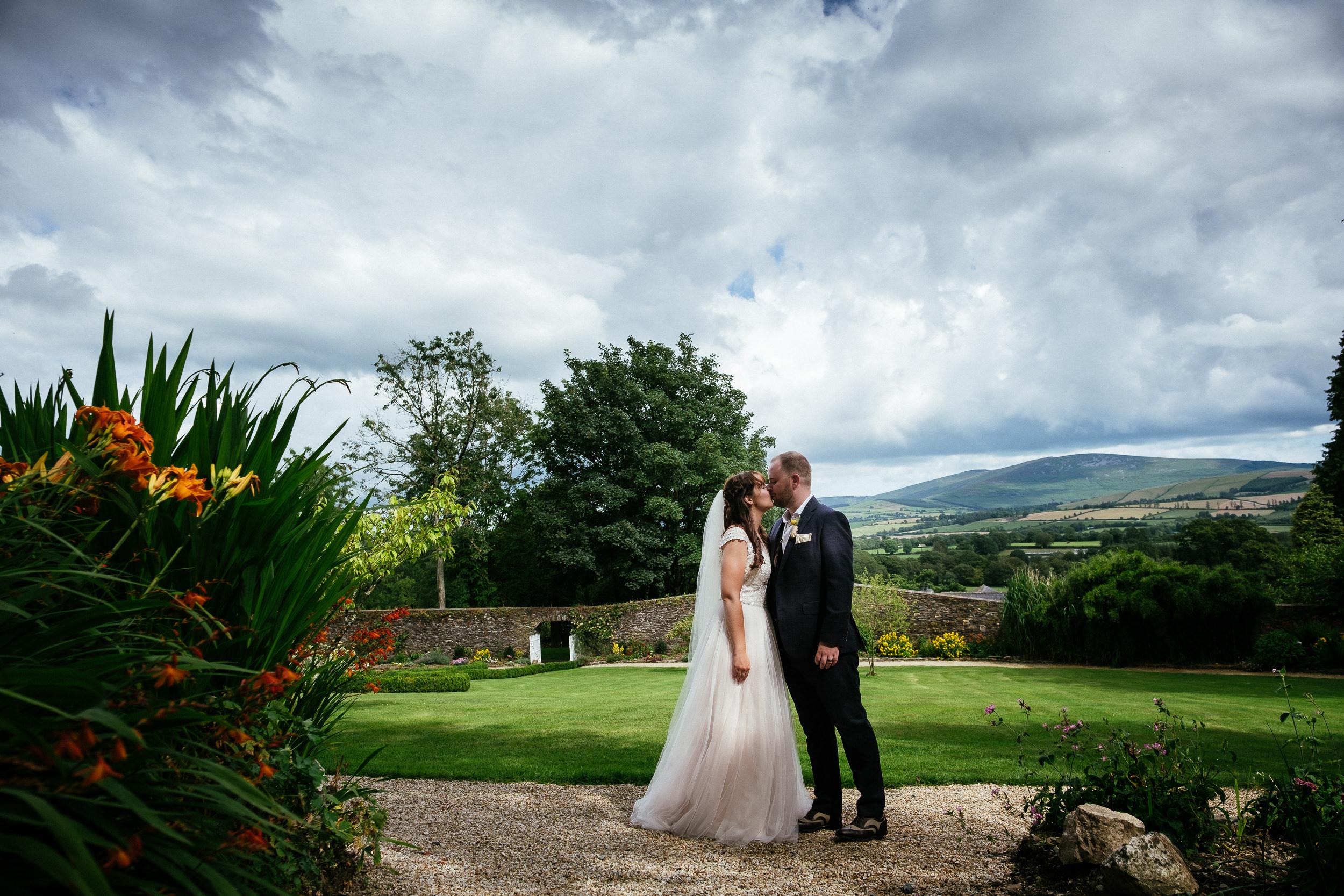 bride and groom walking in walled garden of ballybeg house