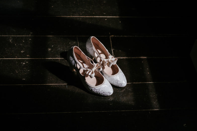 brides shoes in sunlight at ballybeg house