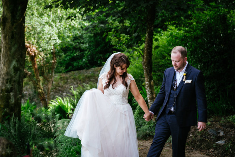bride and groom walking in garden of ballybeg house