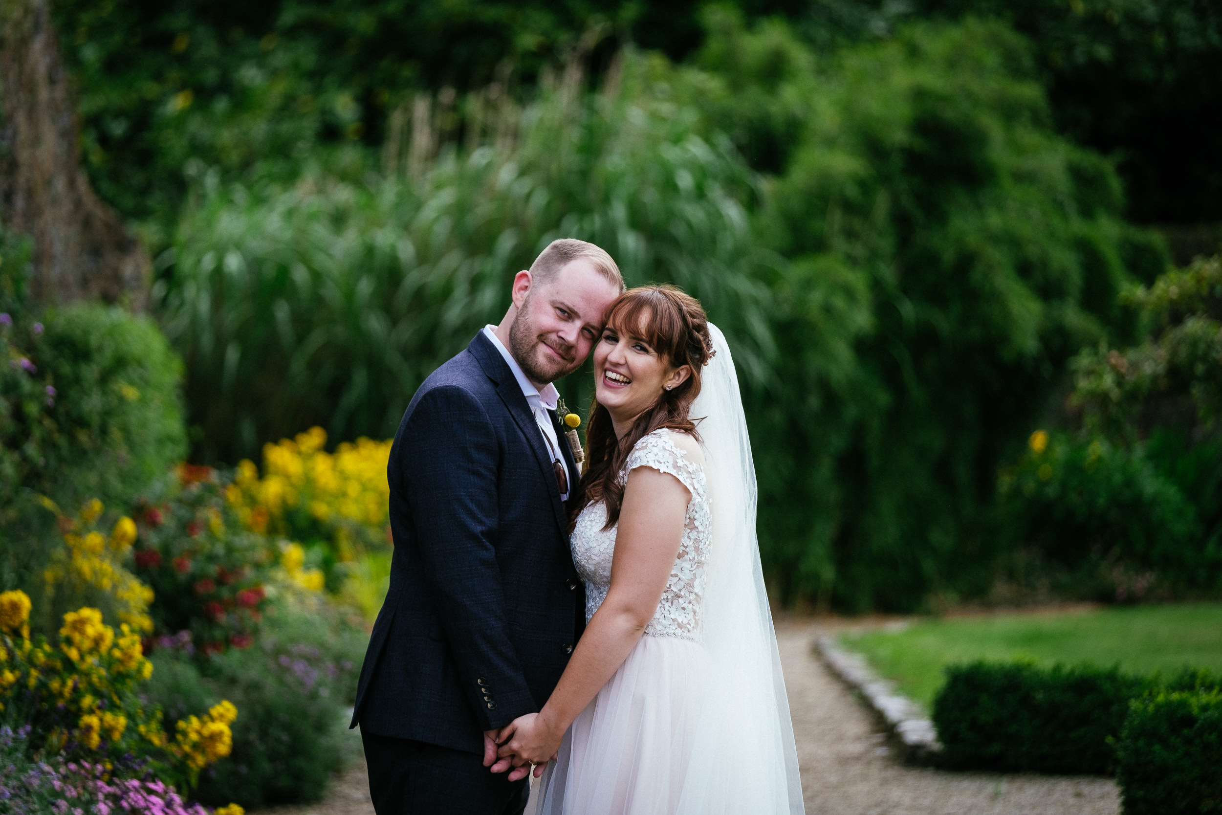 bride and groom looking at the camera in ballybeg house