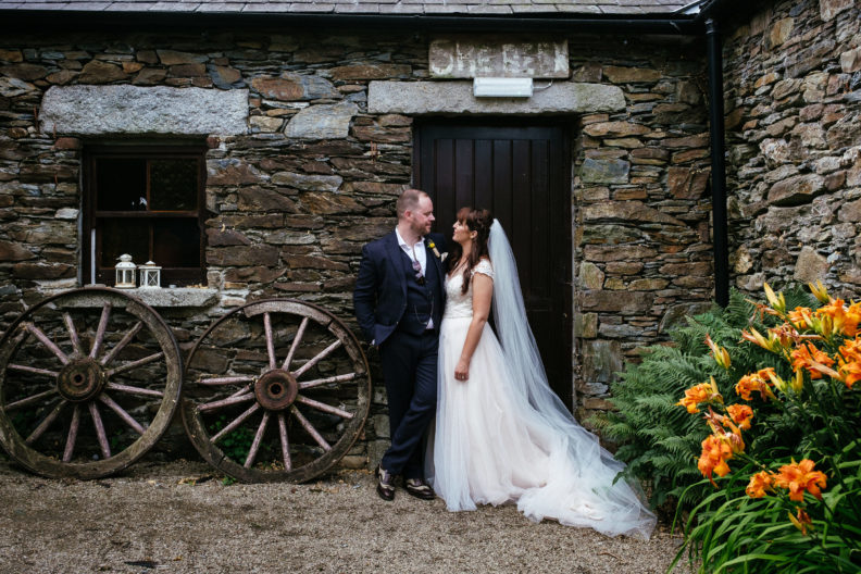 bride and groom standing by a door in ballybeg house