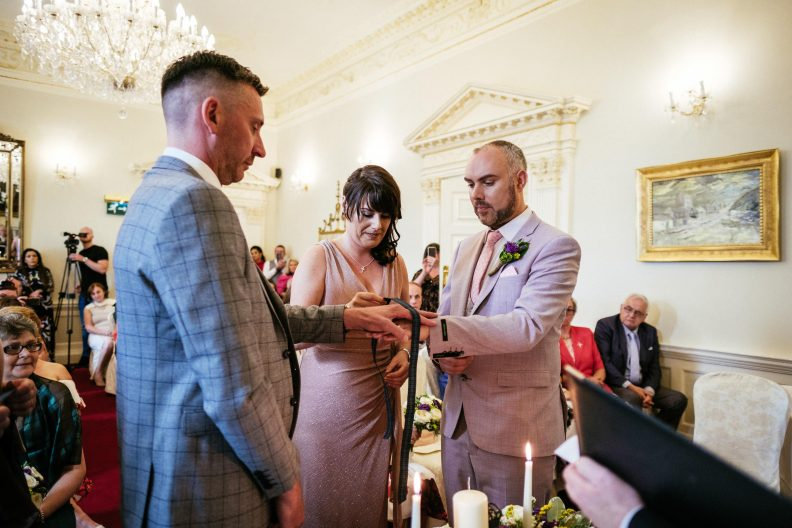 hand fastening ritual during gay wedding ceremony
