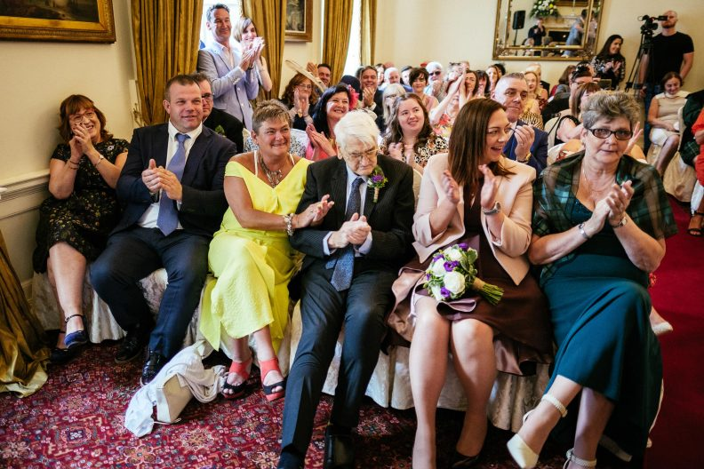 father of gay groom clapping