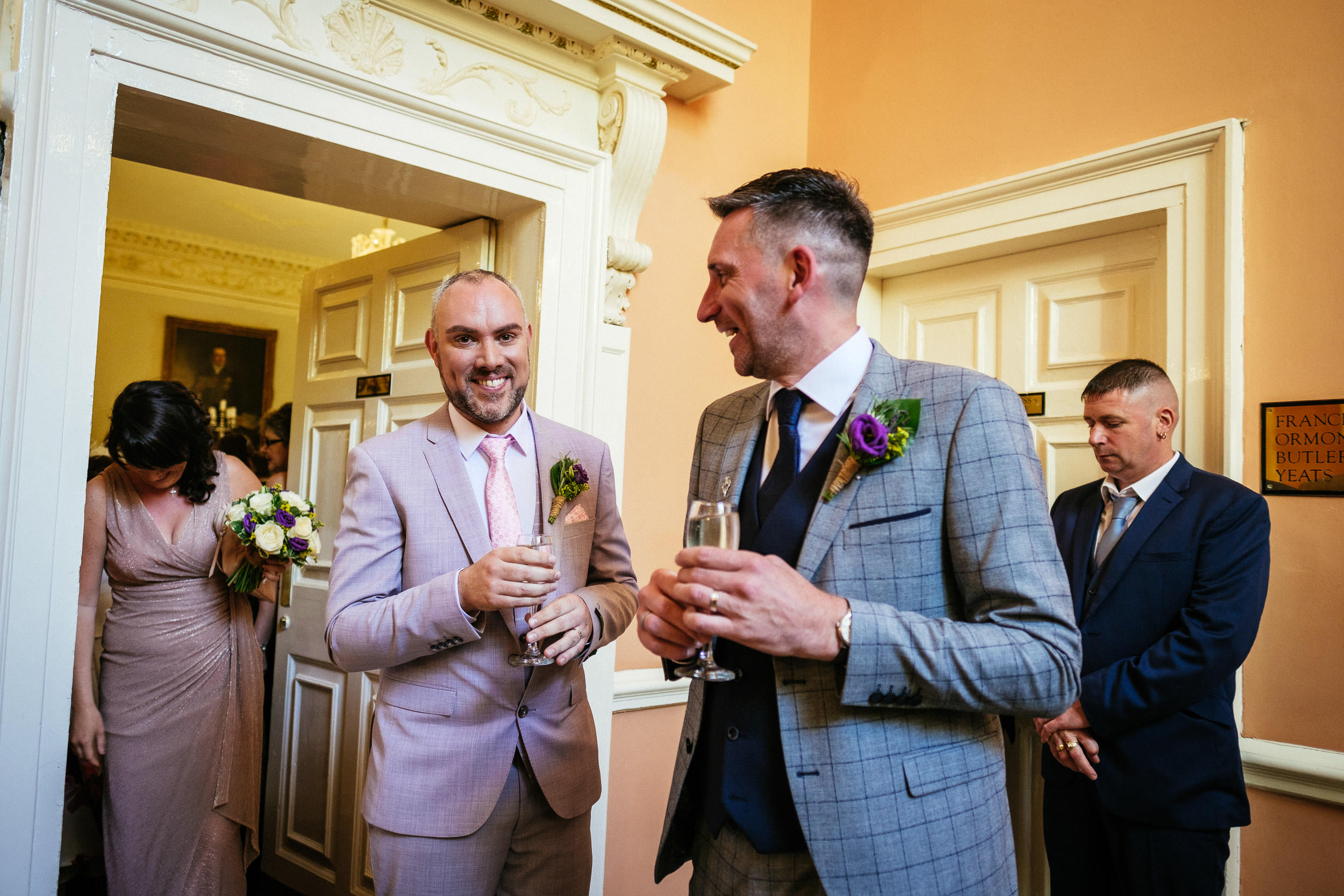 2 grooms having champagne