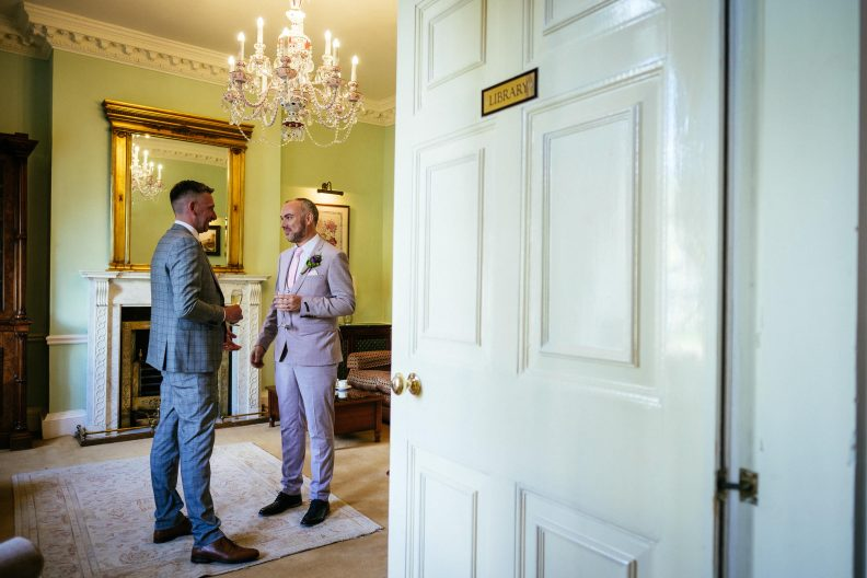2 grooms chatting to eachother