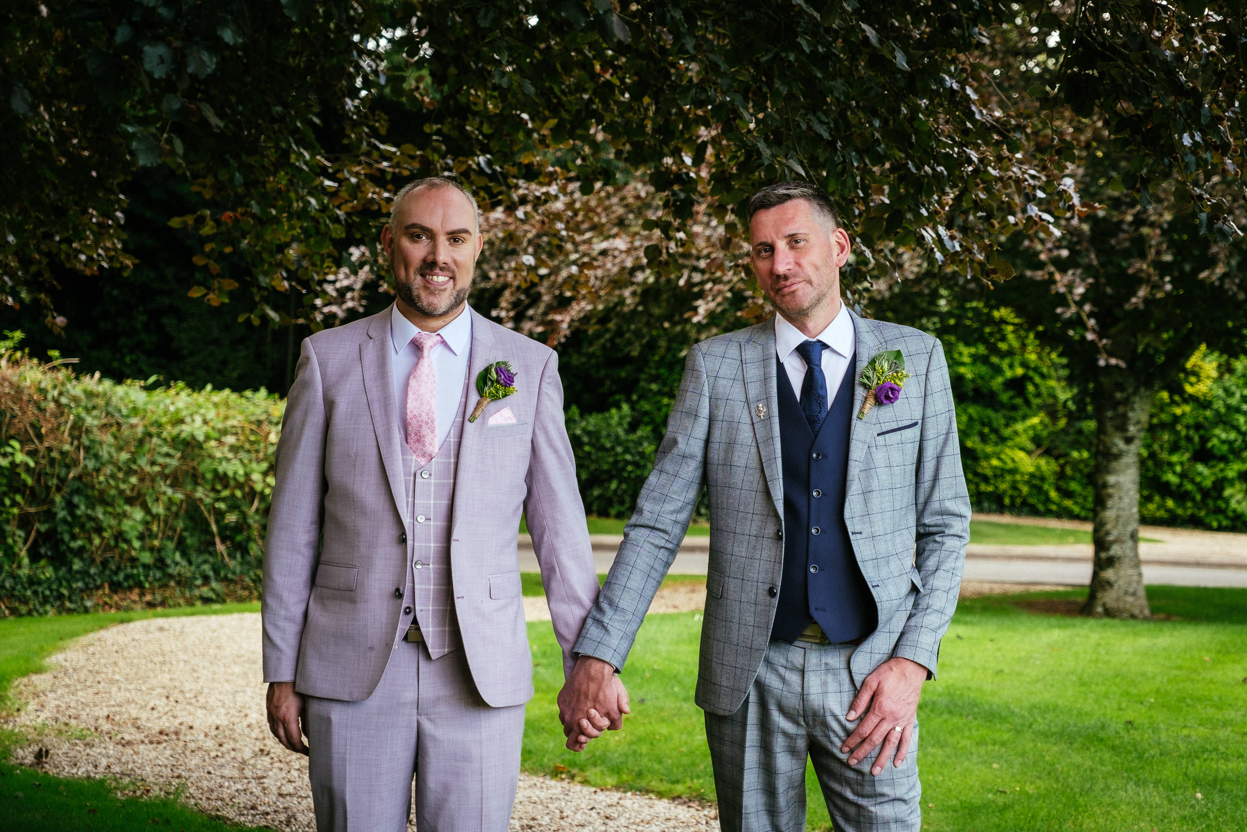 two grooms holding hands