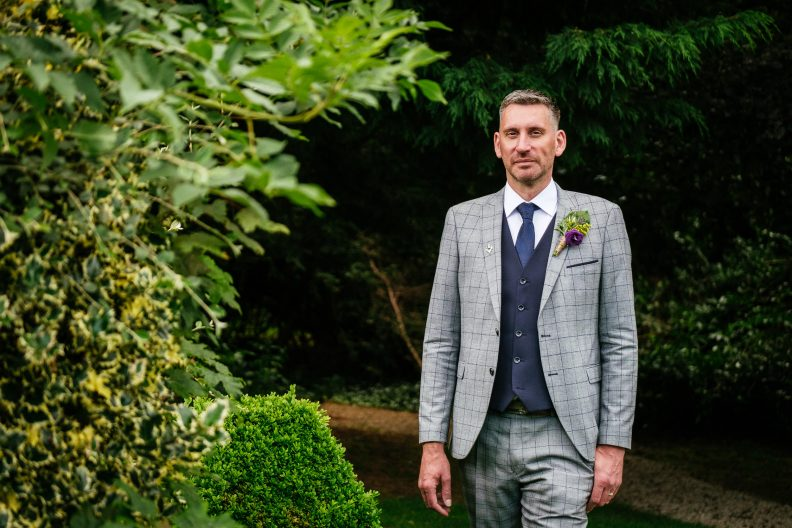 groom posing for a photo