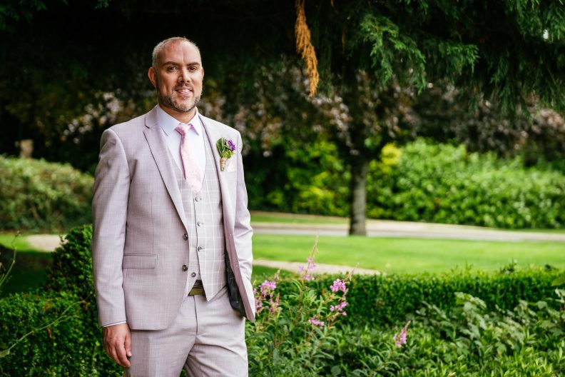 gay groom posing fro a photo