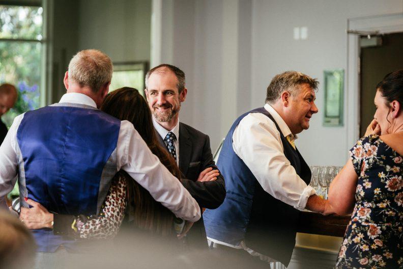 male wedding guest talking