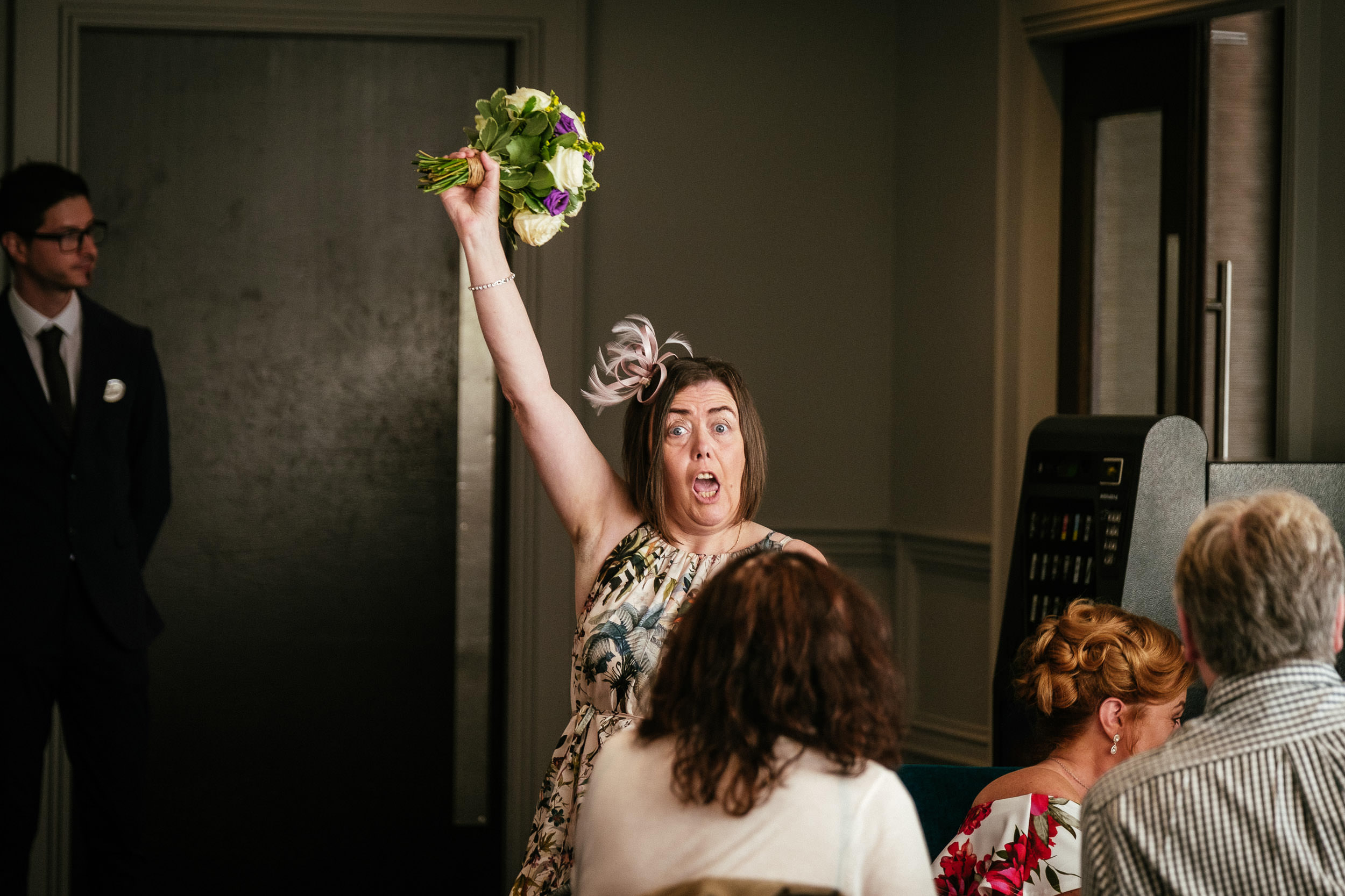 older femaile wedding guest cheering