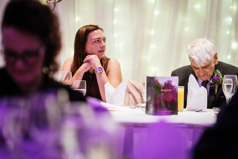 guest listening to a wedding speech