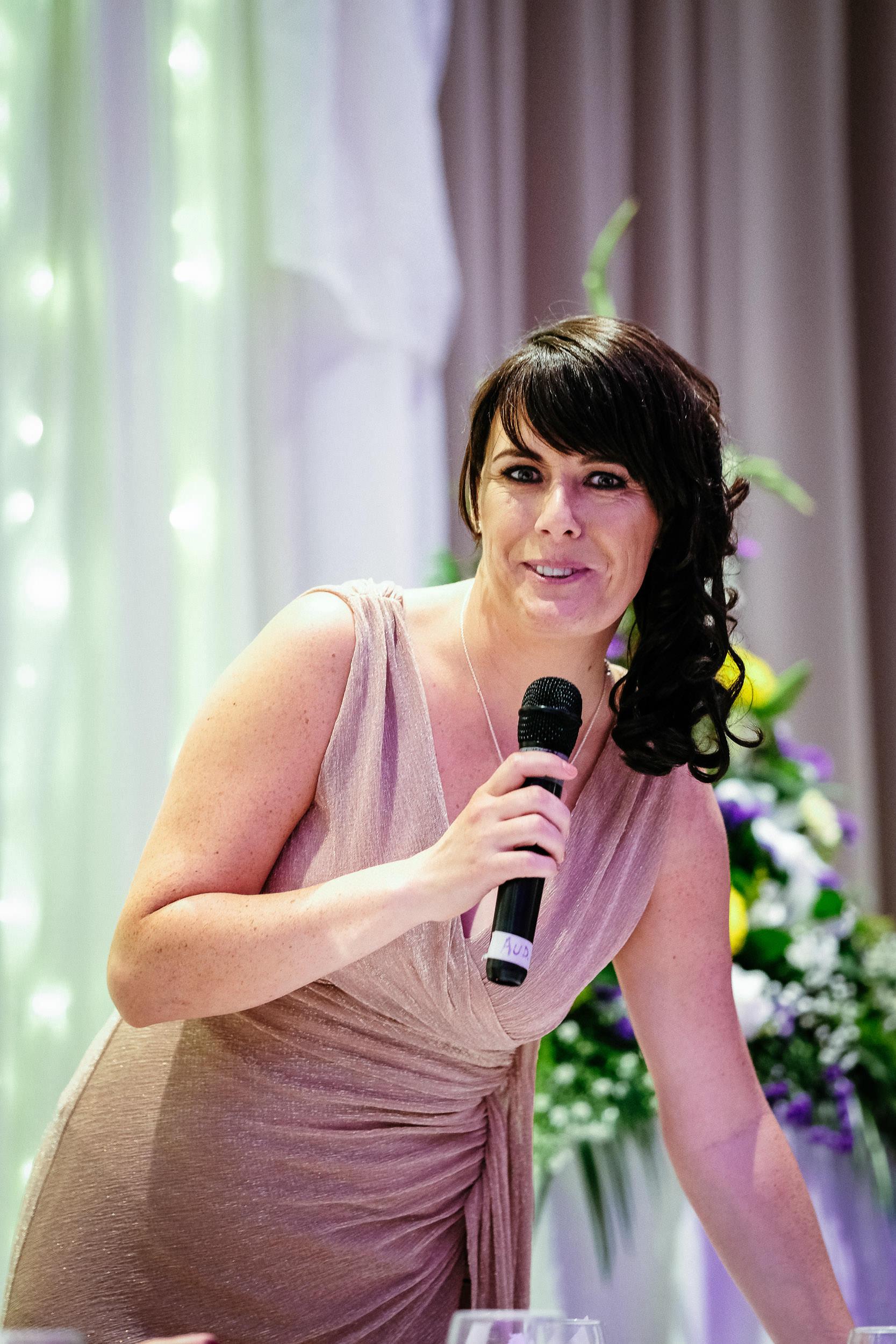 bridesmaid making a wedding speech
