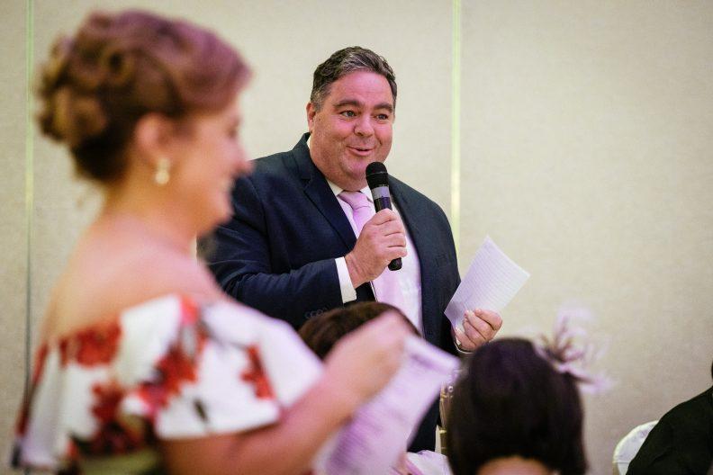male guest making an impromptu wedding speech