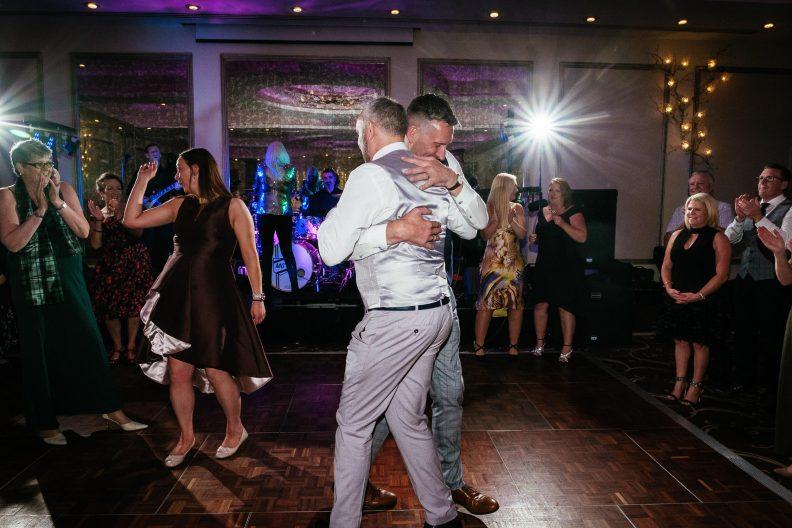 two gay grooms dancing at dunboyne castle