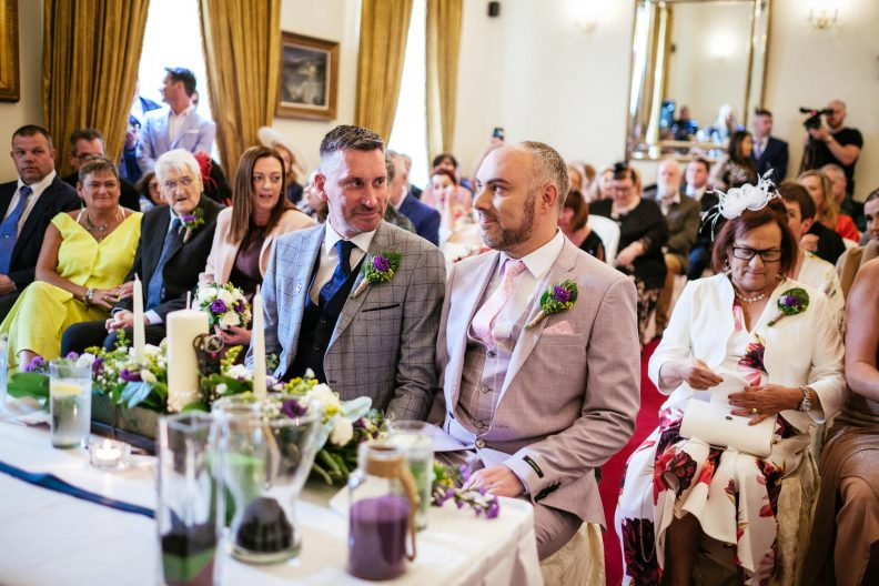 two grooms talking to each other during their wedding ceremony at dunboyne castle