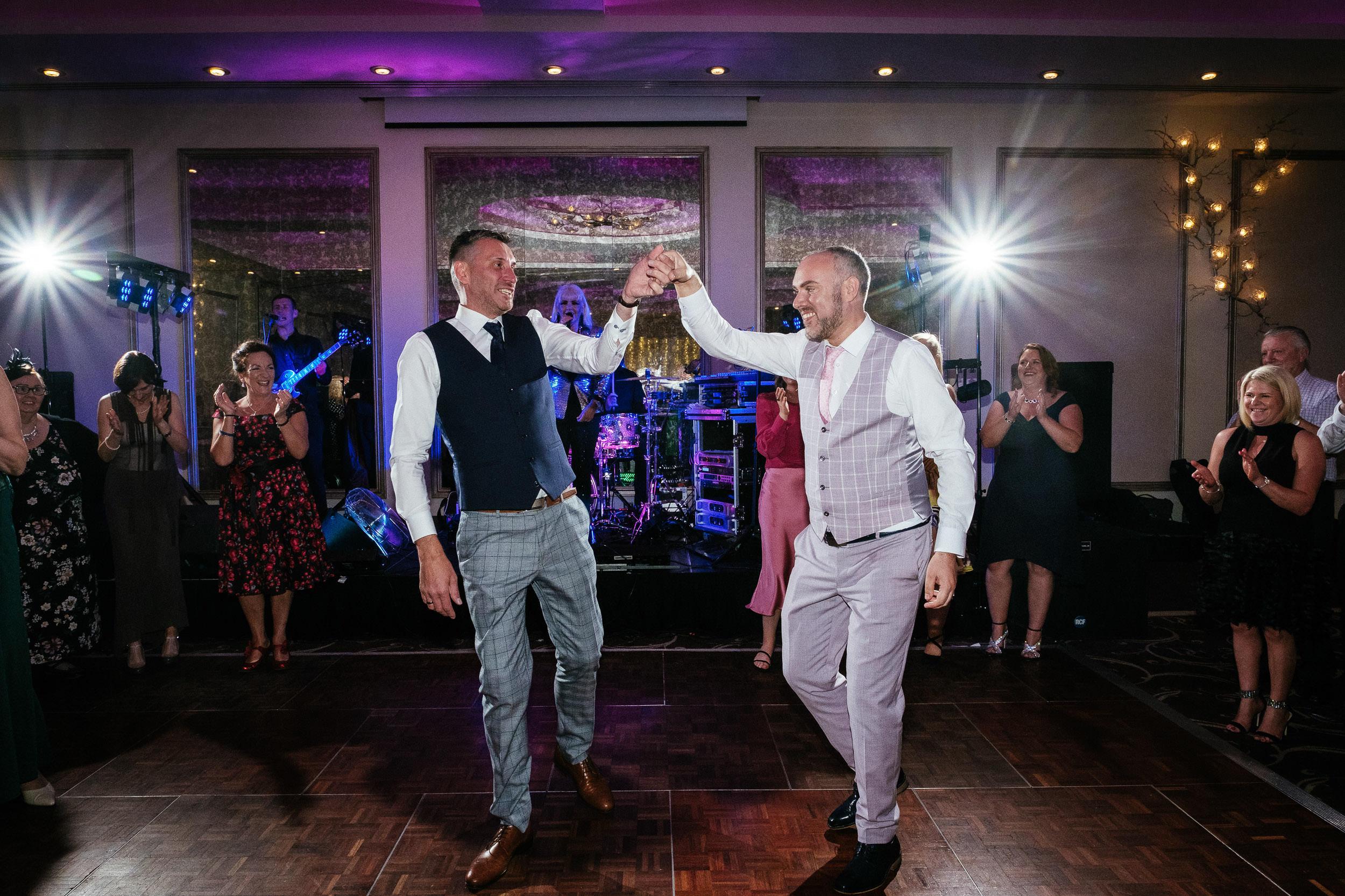 grooms dancing in dancefloor