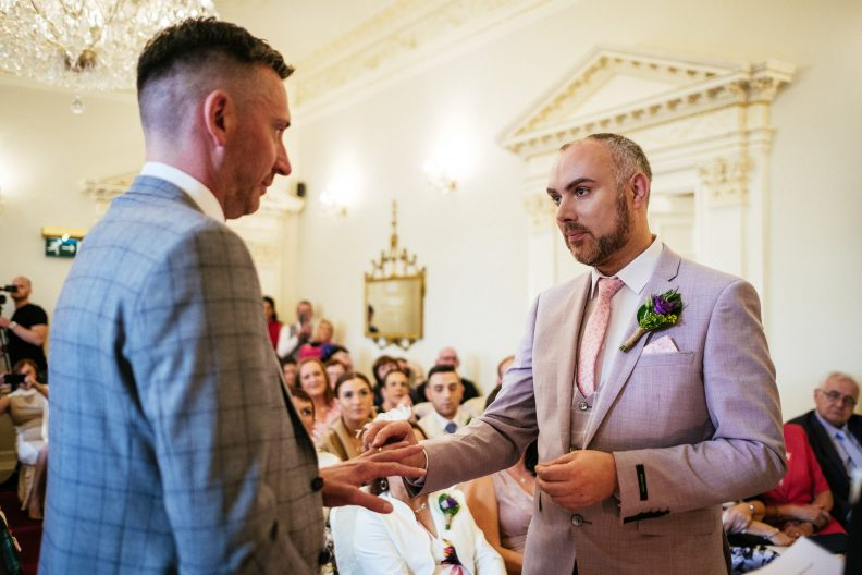 groom taking the hand of his partner