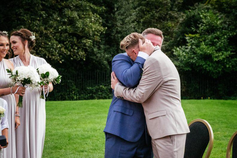 2 grooms hugging