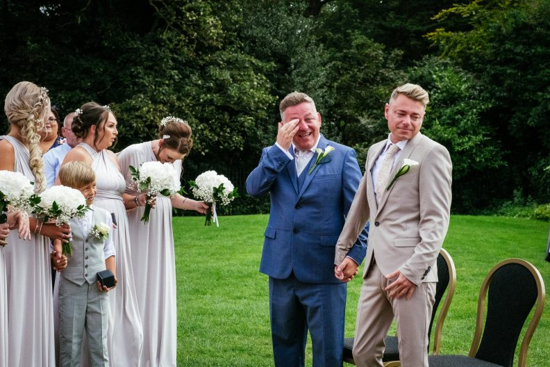 2 grooms crying and laughing