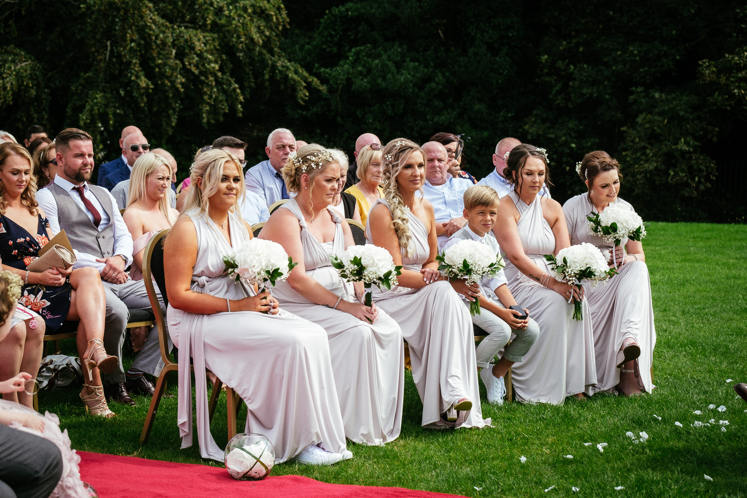 bridesmaids sitting during wedding ceremony