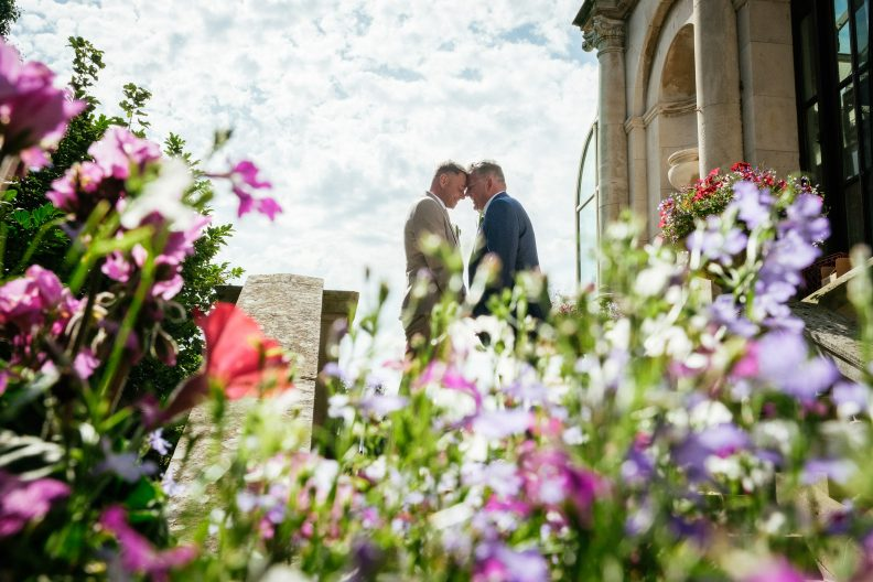 2 grooms touching foreheads