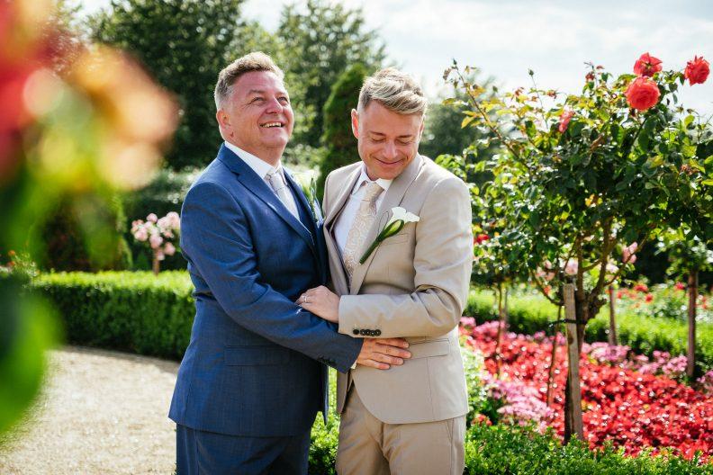 2 grooms dancing during their gay wedding