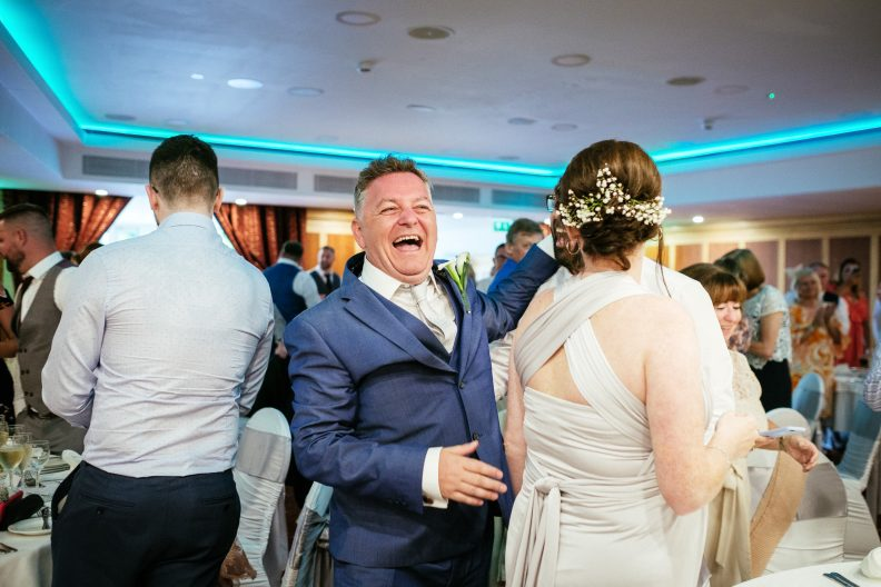groom walking into room for dinner and laughing