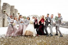 bridal party laughing and joking in the snow at a winter wedding in ireland