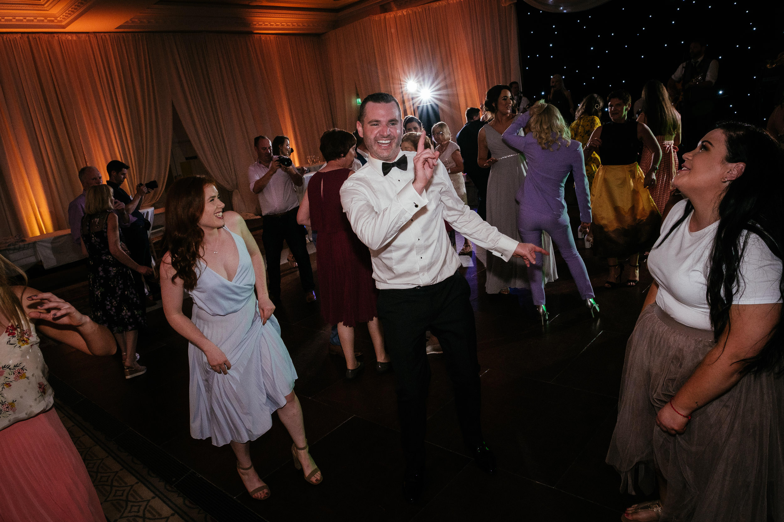 groom dancing at Johnstown House estate