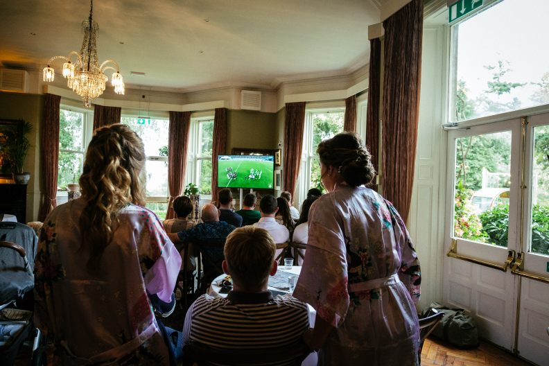 guests watching ireland rugby game at tinakilly house wedding