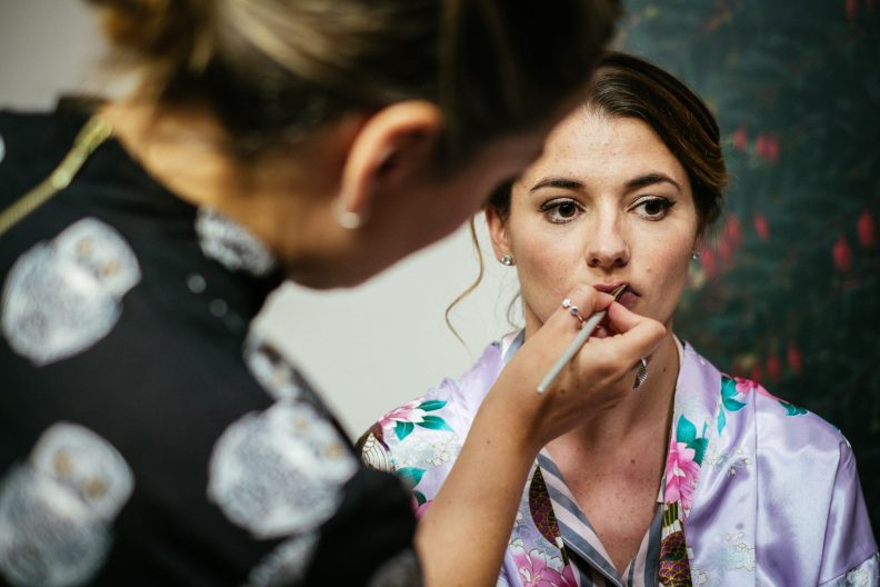 bridesmaid getting lipgloss