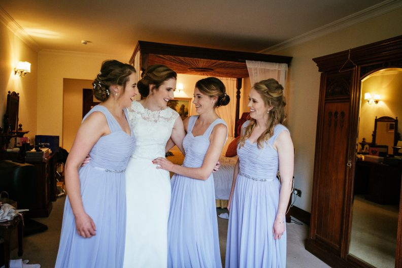 bridesmaids chatting in bridal suite