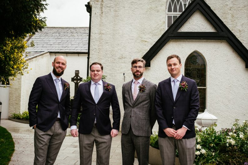 groom and groomsmen outside church