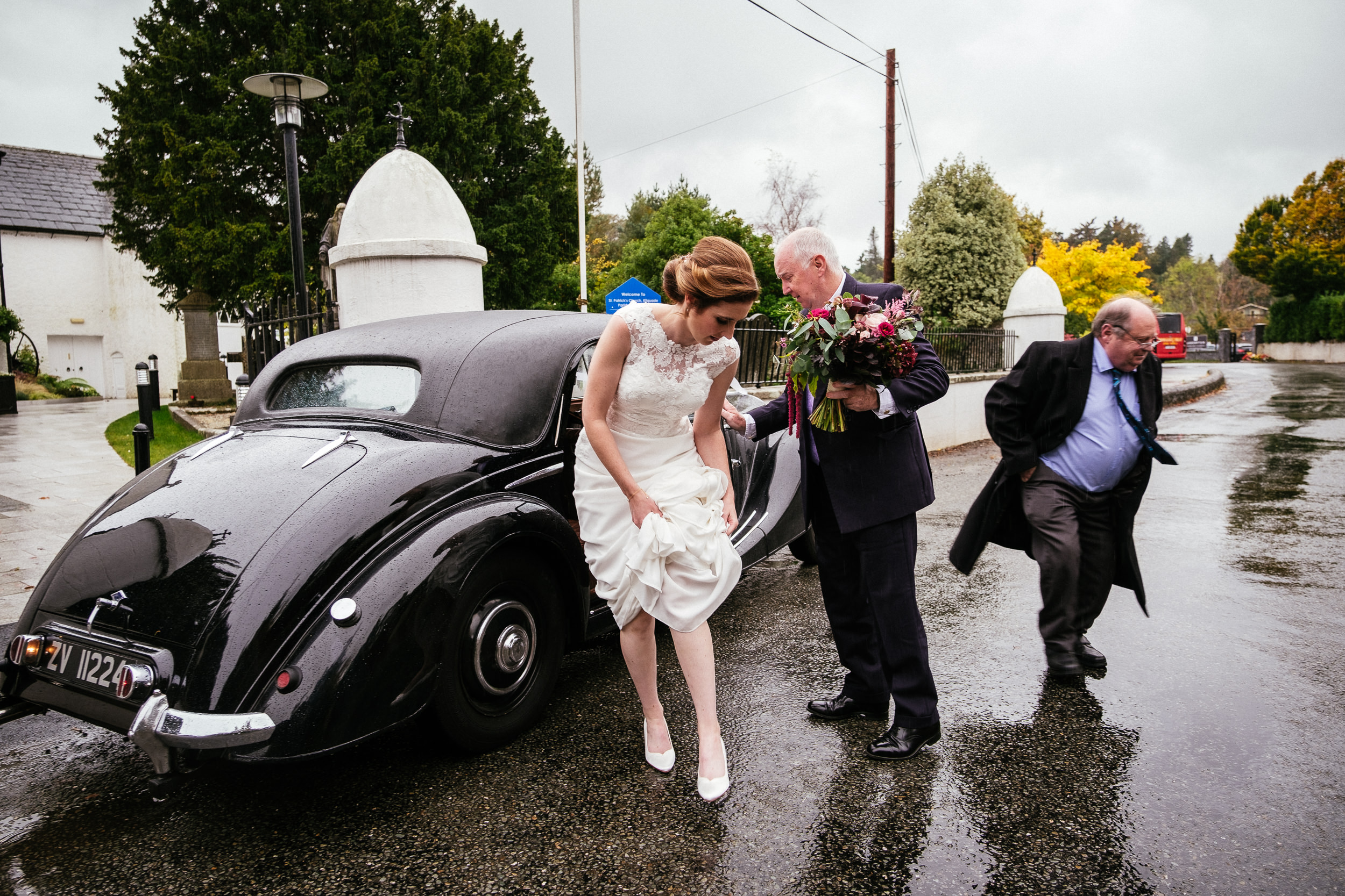 bride getting out of wedding car at tinakilly house wedding