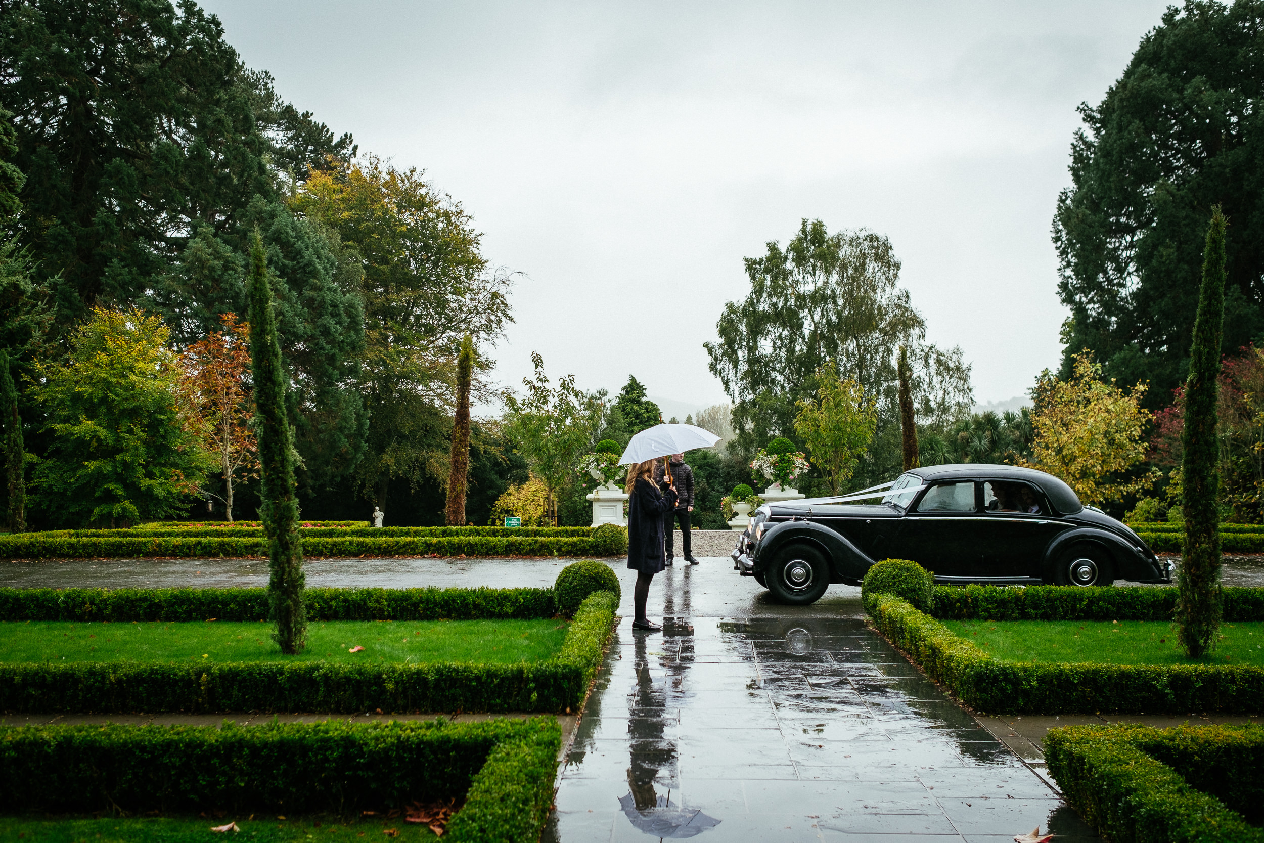 bride and groom arriving by car at their tinakilly house wedding