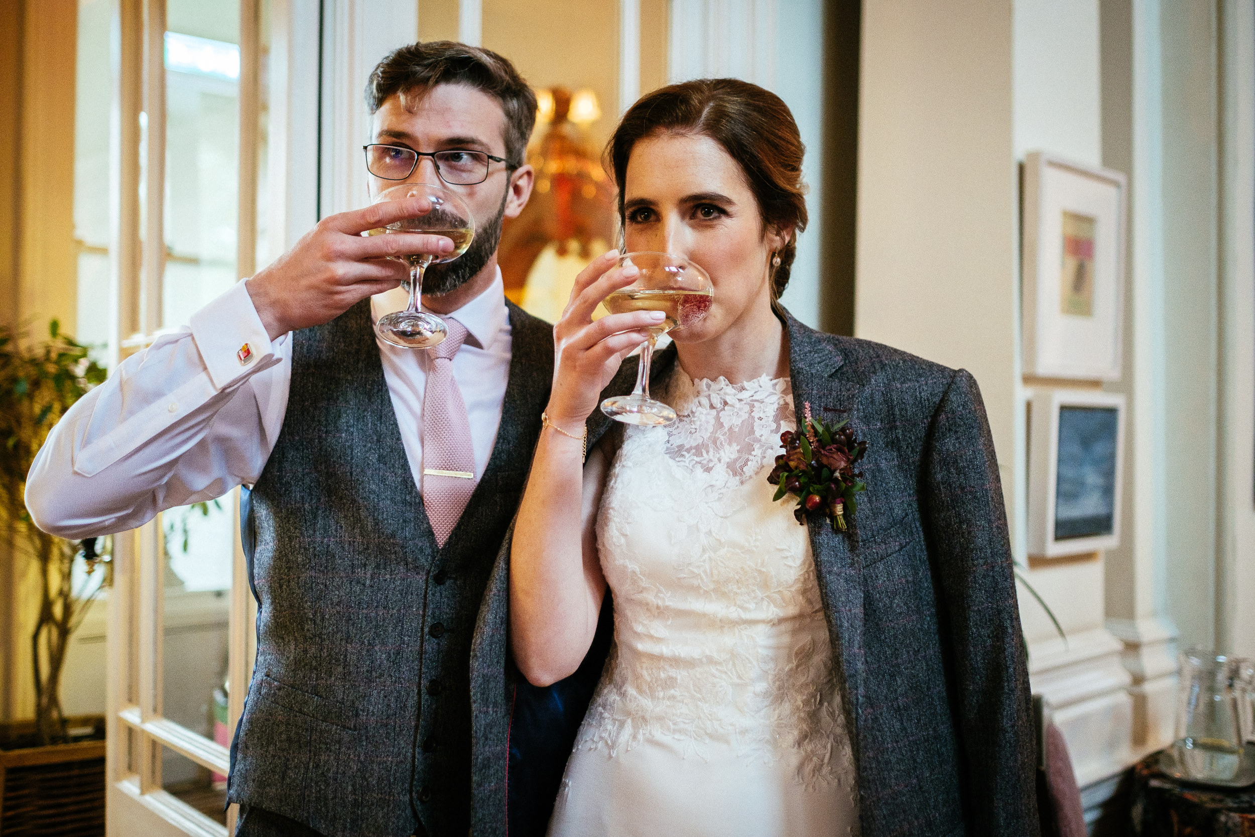 bride and groom drinking champagne at tinakilly house Wicklow