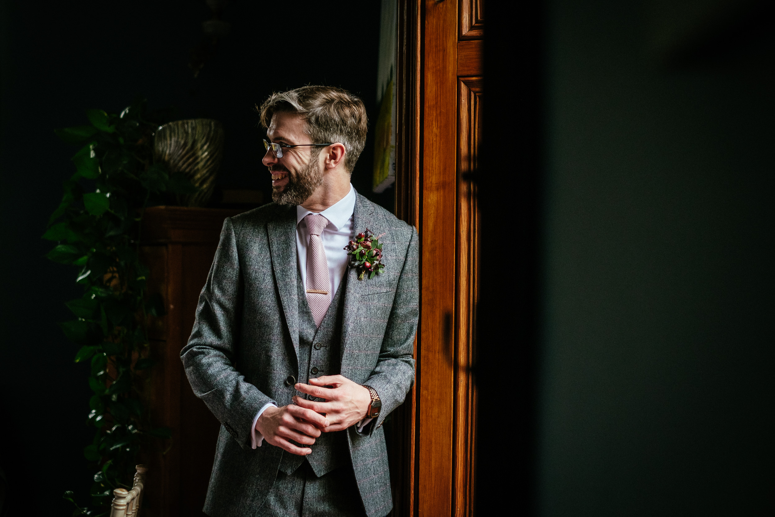 groom standing by a window at tinakilly house