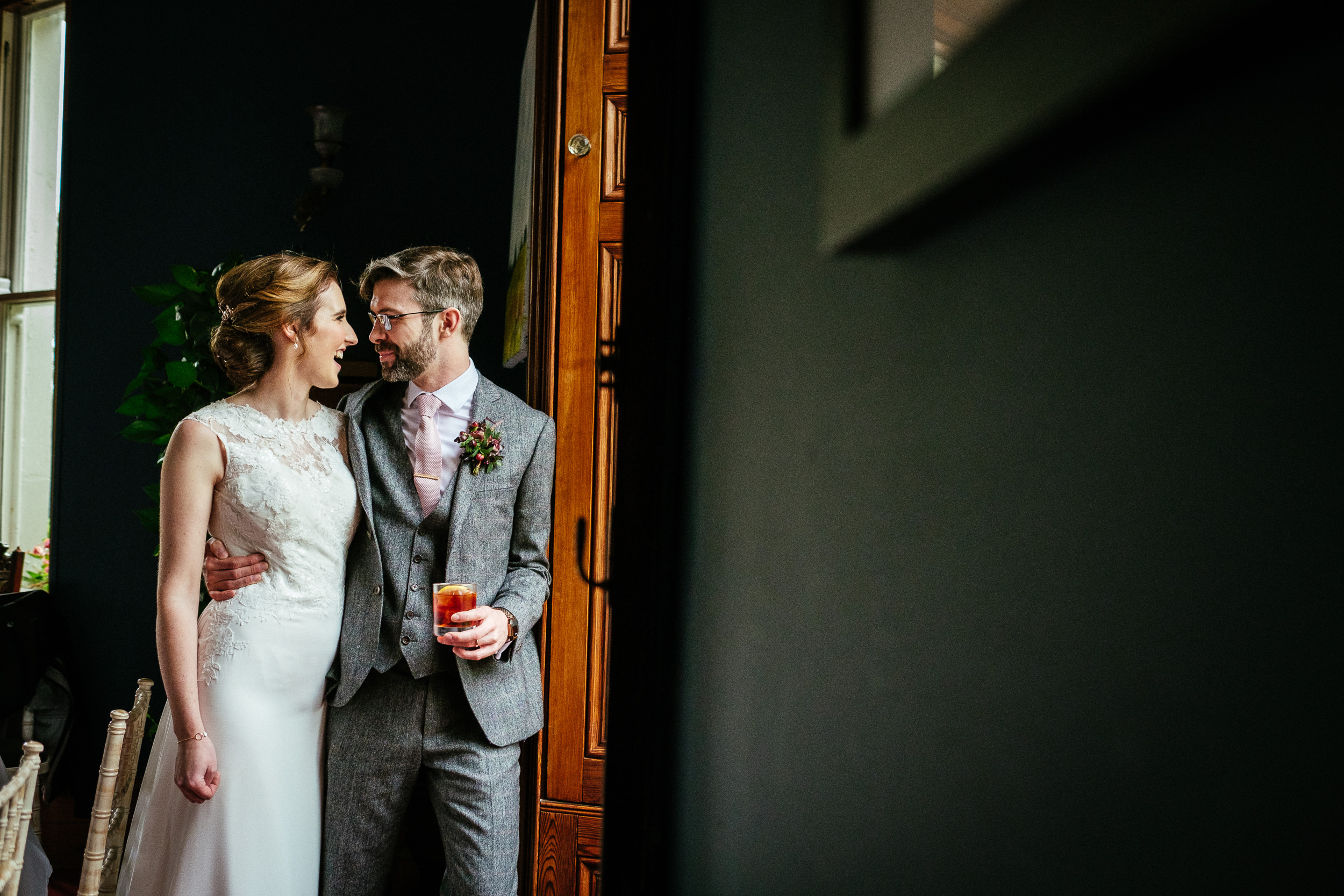 bride and groom looking at each other by a window in tinakilly house