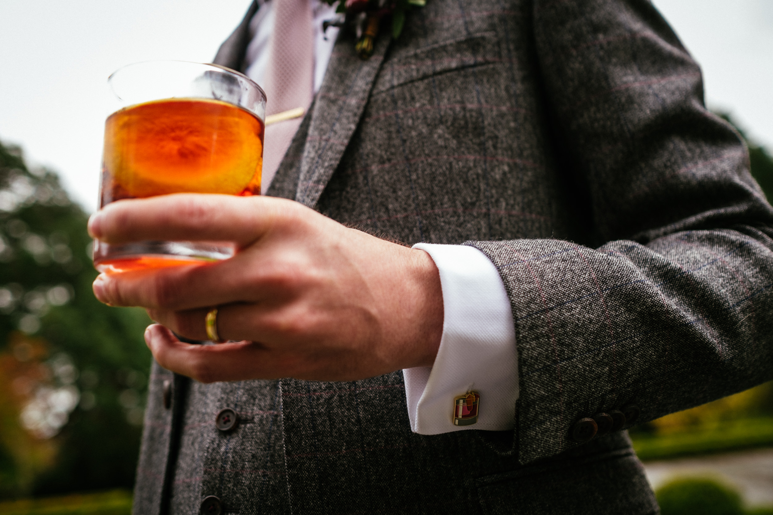 groom holding a drink
