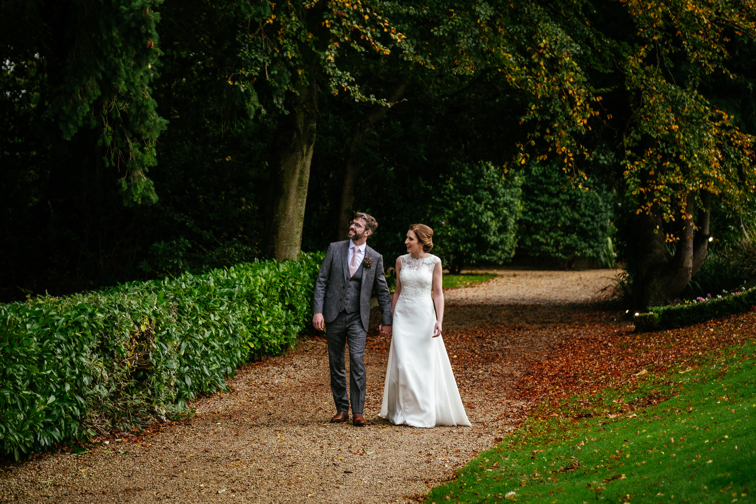 bride and groom walking in gardens of tinakilly house wedding