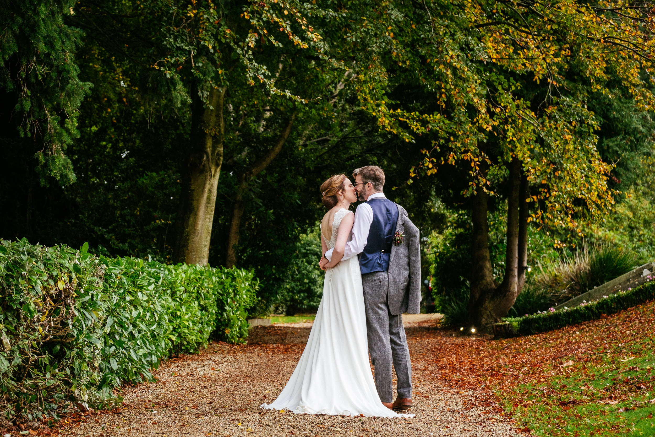 bride and groom embracing in gardens of tinakilly house