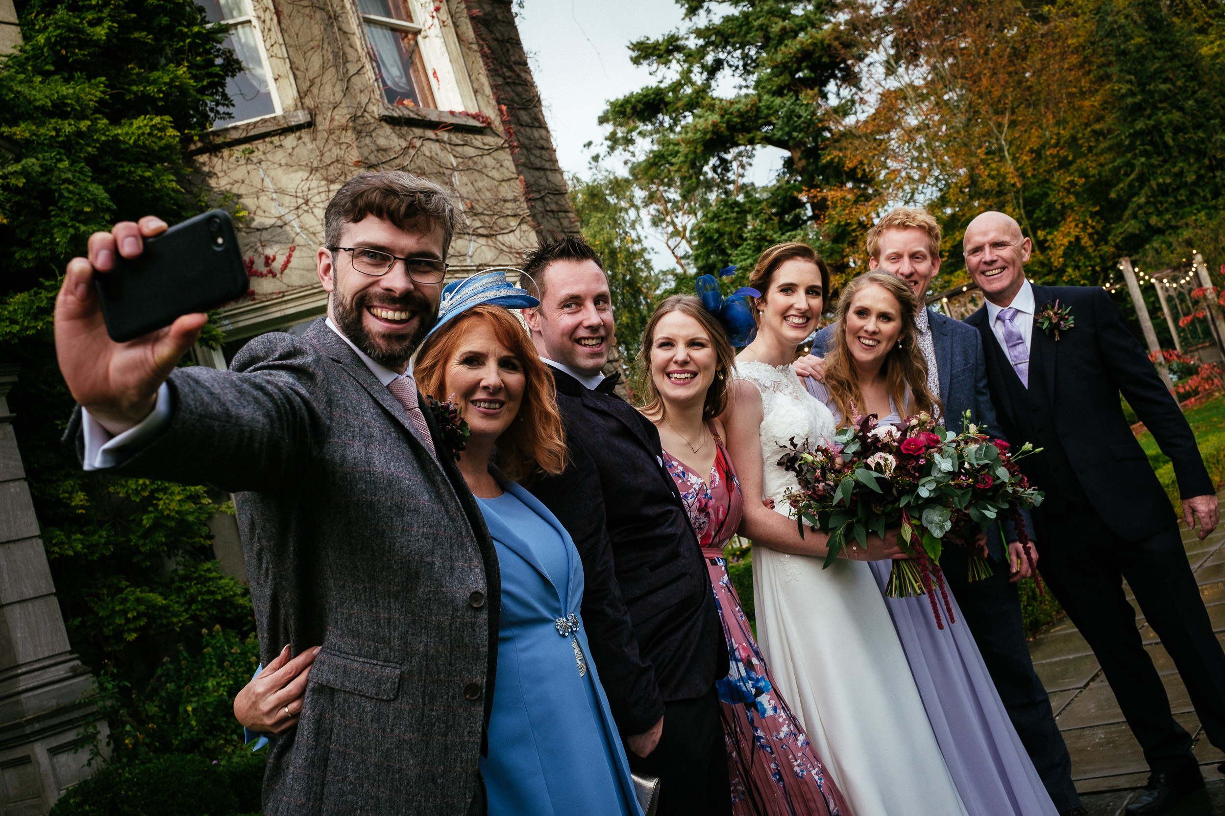 bridal party taking a selfie in front of tinakilly house