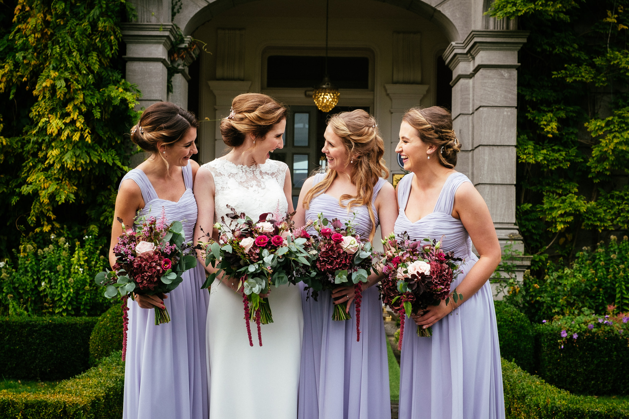 bridesmaids chatting and posing in front of tinakilly house