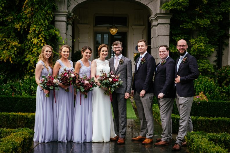 bridal party posing in front of tinakilly house