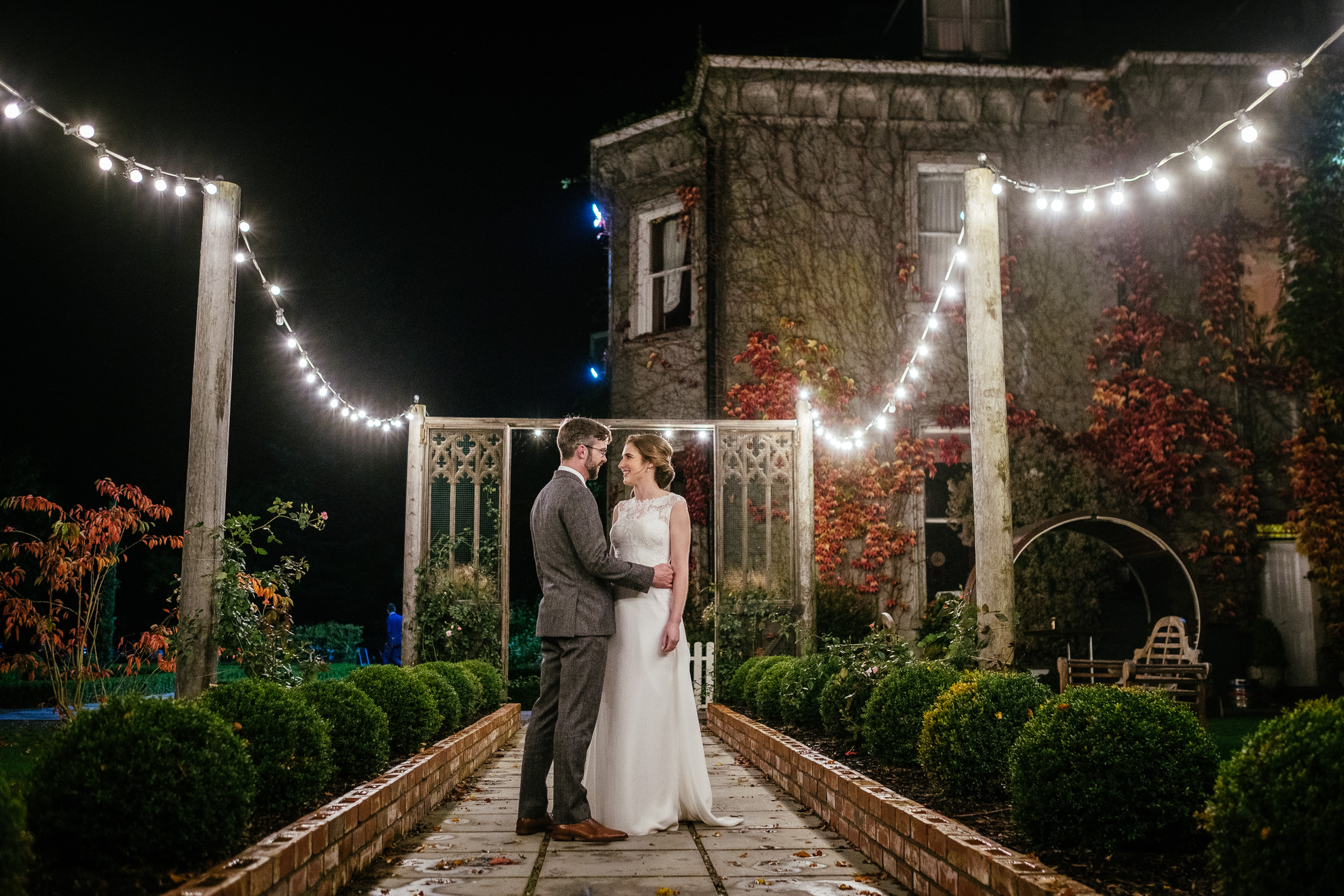 bride and groom under the outdoor fairy lights during their Autumn Wedding at Tinakilly House