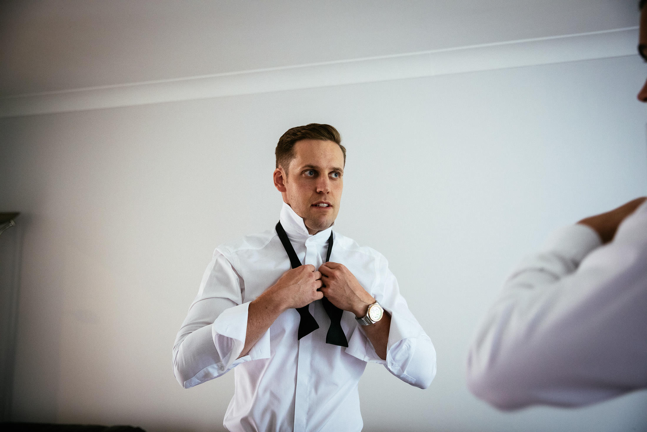 groom getting ready before his knightsbrook hotel wedding