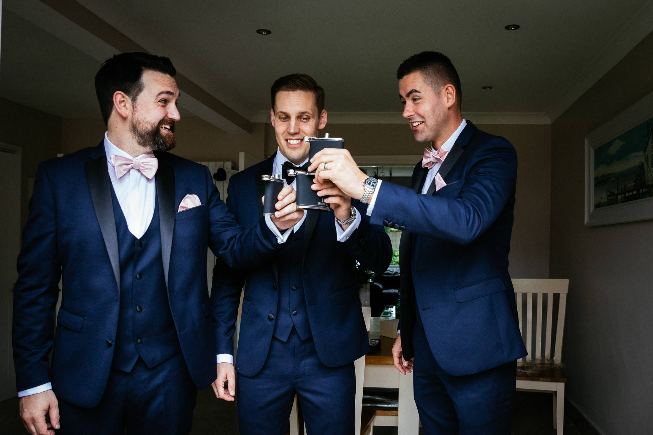 groom and groomsmen drinking before their knightsbrook hotel wedding
