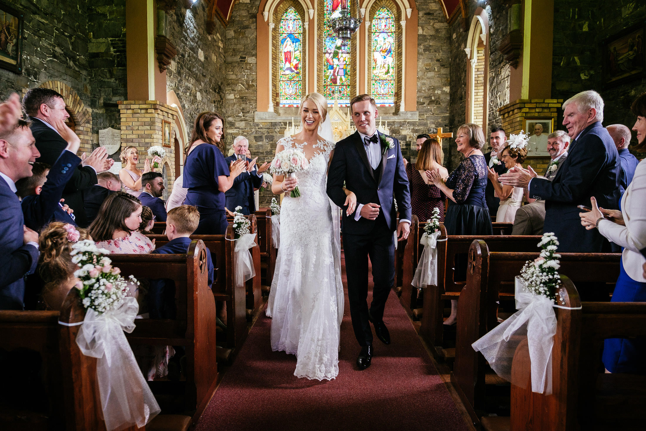 bride and groom walking down aisle after getting married in Culmullen Church before their Wedding in the Knightsbrook Hotel