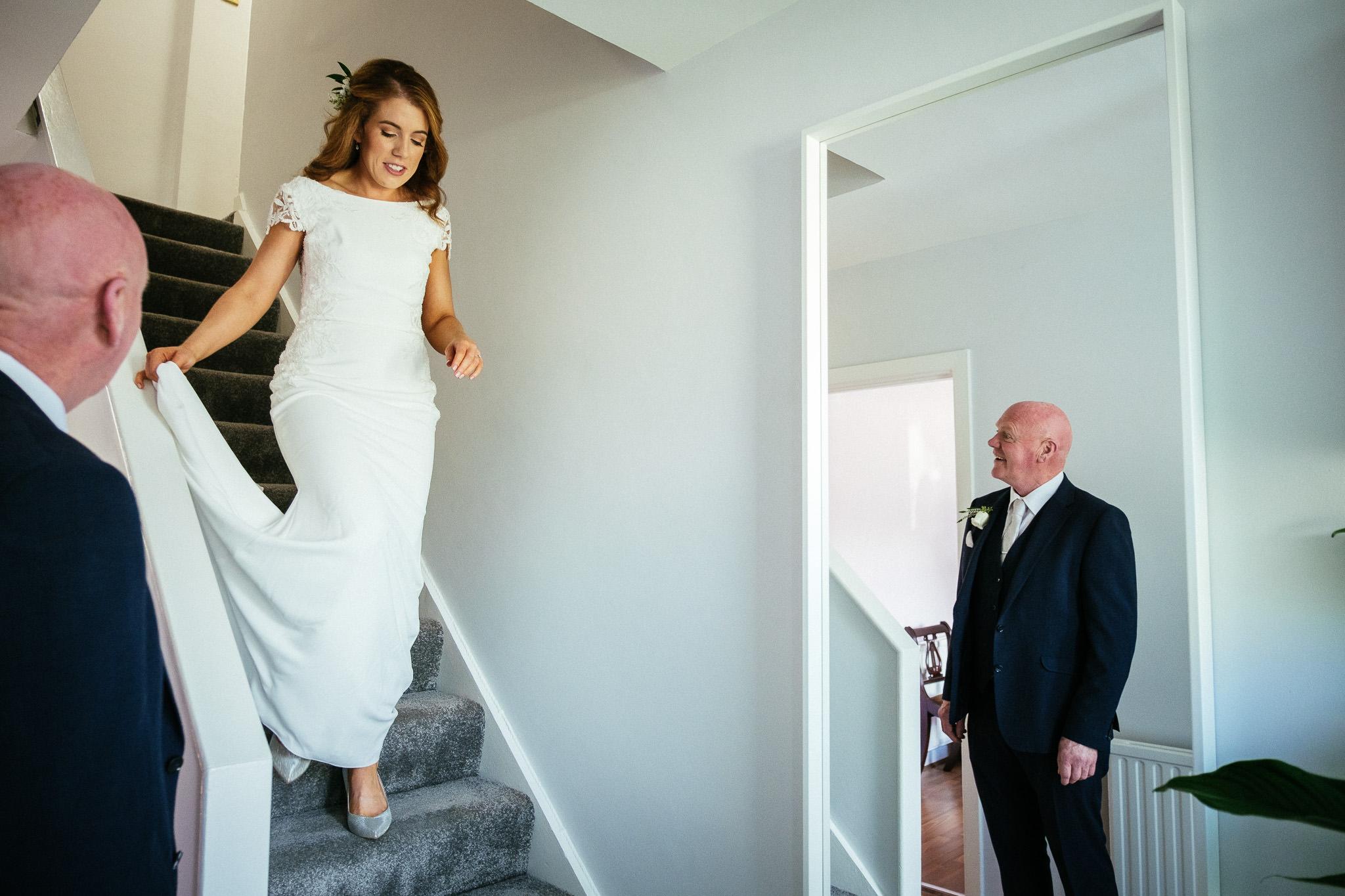 bride coming down stairs to her father